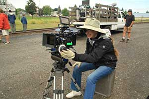 Director Cornelia Duryée takes a look at the next shot on 'West of Redemption.'